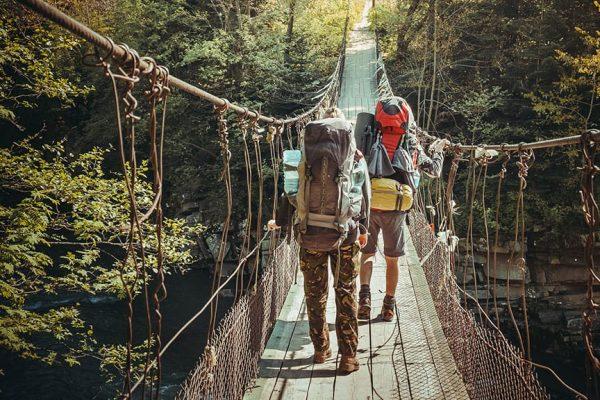travelers-crossing-through-hanging-bridge.jpg